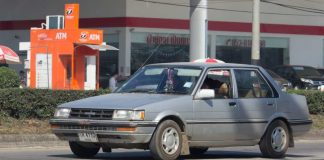 Private Old car, Toyota Corolla. Photo at road no 121 about 8 km from downtown Chiangmai, thailand.