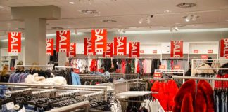 Buyers in H&M clothing store. H&M Hennes & Mauritz AB is a Swedish multinational clothing-retail company, clothing for men, women, teenagers and children.