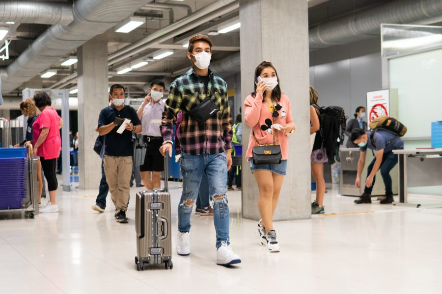 People wear face masks Covid-19 protect at airport