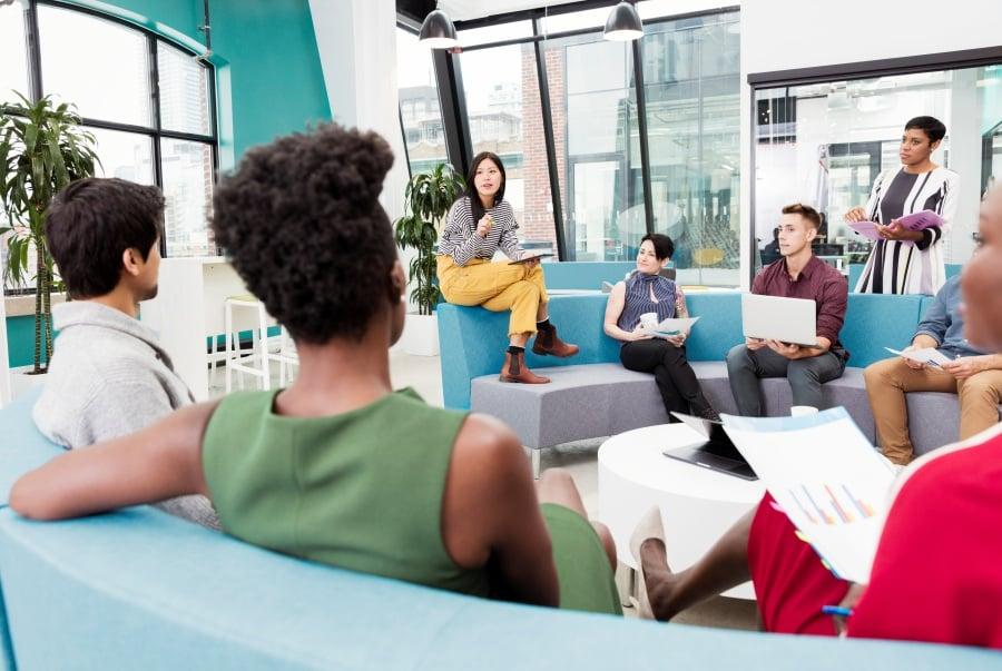 informal meeting in modern open plan office